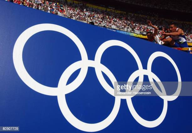 The Olympic rings are seen during a heat of the 110m Hurdles in the Men's Decathlon at the National Stadium on Day 14 of the Beijing 2008 Olympic...