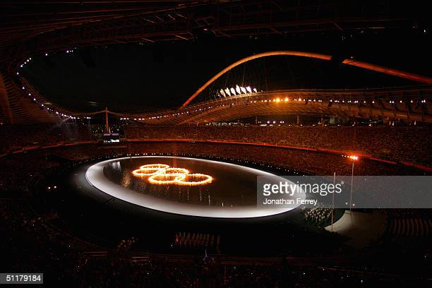 The Olympic Rings are seen during opening ceremonies for the Athens 2004 Summer Olympic Games on August 13, 2004 at the Sports Complex Olympic...