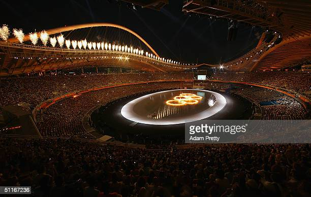 The Olympic rings are seen during the opening ceremony of the Athens 2004 Summer Olympic Games on August 13, 2004 at the Sports Complex Olympic...