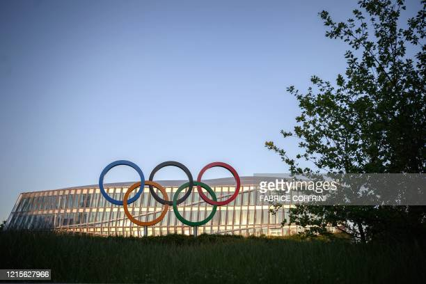 The Olympic Rings are seen in front of the International Olympic Committee headquarters at sunset in Lausanne on May 27, 2020.