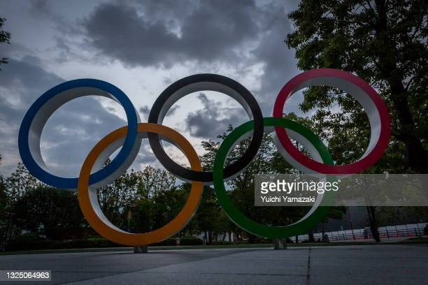 The Olympic Rings are seen in front of the National Stadium on June 23, 2021 in Tokyo, Japan. Today marks one month to go until the start of the...