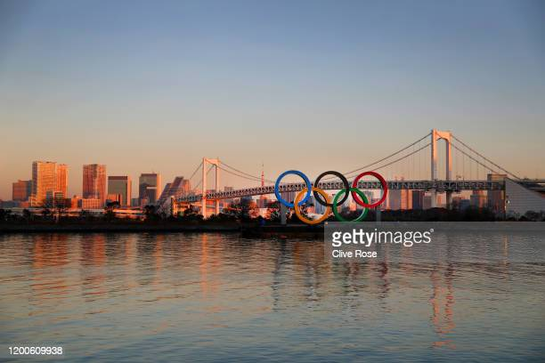 The Olympic rings are seen in front of Tokyo's iconic Rainbow Bridge and Tokyo Tower at Odaiba Marine Park on January 20 2020 in Tokyo Japan