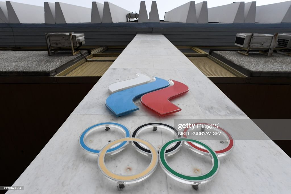 The Olympic rings are seen on the facade of the Russian Olympic Committee (ROC) building in Moscow on December 05, 2017. The International Olympic Committee (IOC) meets from Tuesday, December 5, 2017 to decide whether to bar Russia from the 2018 Winter Olympics for doping violations, in one of the weightiest decisions ever faced by the Olympic movement. / AFP PHOTO / Kirill KUDRYAVTSEV