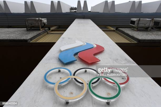 The Olympic rings are seen on the facade of the Russian Olympic Committee building in Moscow on December 05 2017 The International Olympic Committee...