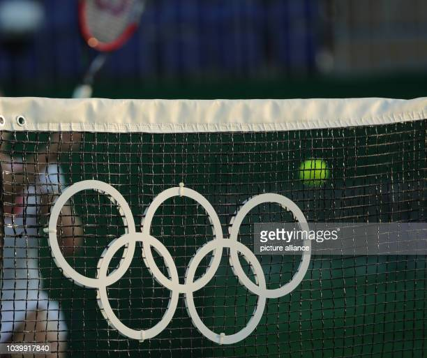 The Olympic rings are seen on the net during the match Petkovic of Germany against Svitolina of Ukraine during the Tennis Women's Singles First Round...