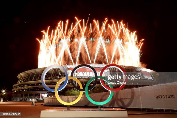 The Olympic Rings are seen outside the stadium as fireworks go off during the Opening Ceremony of the Tokyo 2020 Olympic Games at Olympic Stadium on...