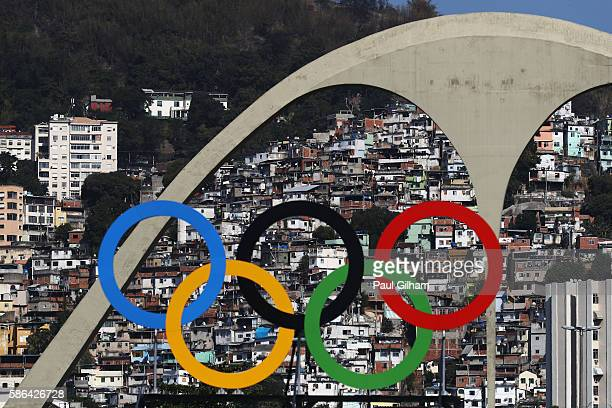 The Olympic Rings are seen with favelas in the background during the Men's Team Quarter Finals on Day 1 of the Rio 2016 Olympic Games at the...