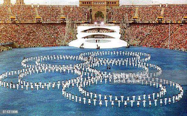 The Olympic rings are set on the pitch during the opening ceremony of the XXVth Summer Olympics 25 July 1992 at Montjuic Stadium Approximately 12000...