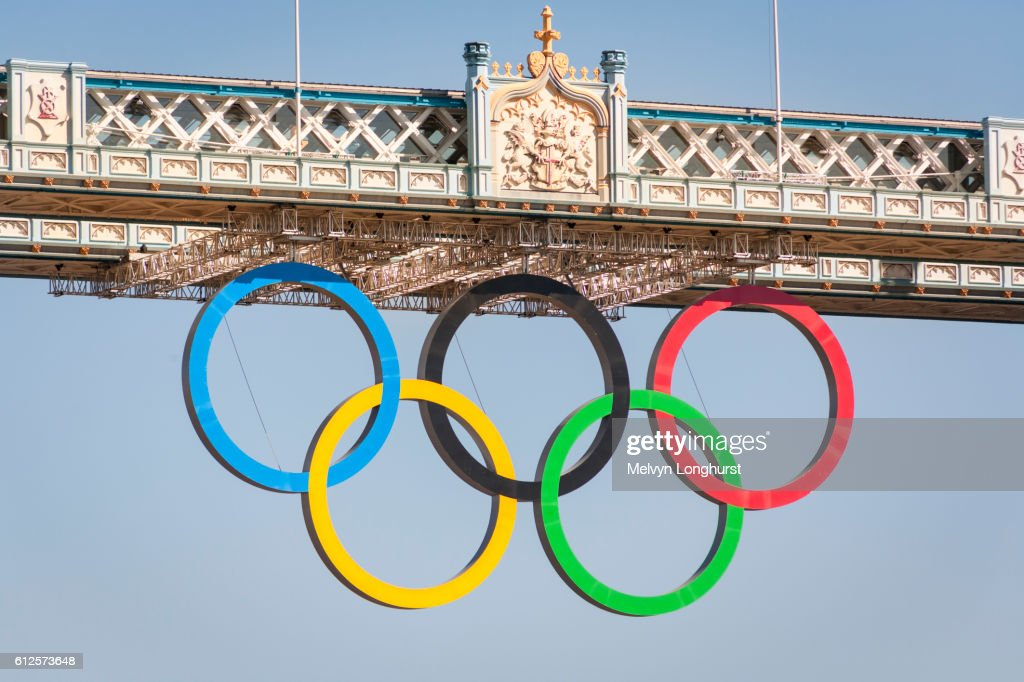 The Olympic rings, celebrating the 2012 Olympic Games, suspended from Tower Bridge, London, England : Stock Photo