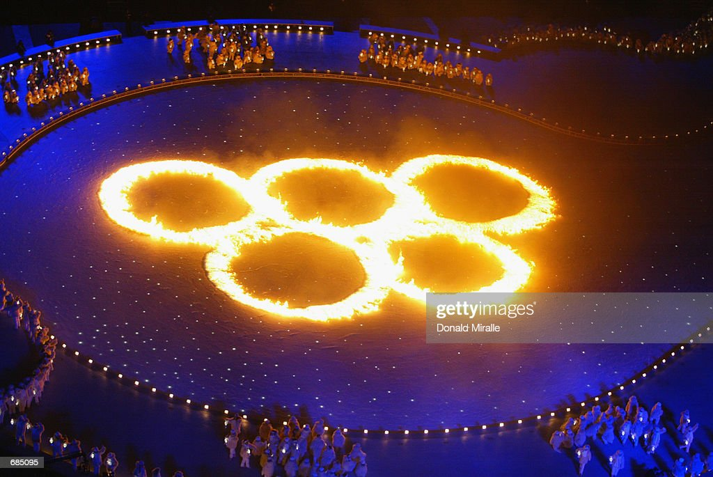 The Olympic Rings in flames during the Opening Ceremony of the Salt Lake City Winter Olympic Games at the Rice-Eccles Olympic Stadium in Salt Lake City, Utah on February 8, 2002.