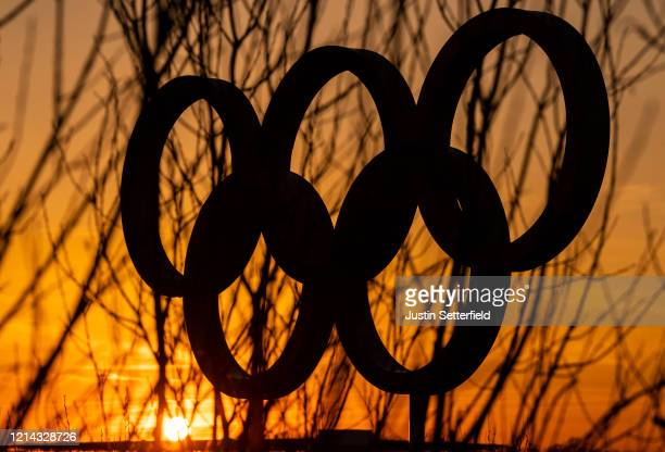 The Olympic rings in the Olympic Park in Stratford as Tokyo Olympics organisers are considering options to delay the Olympics with teams treating to...