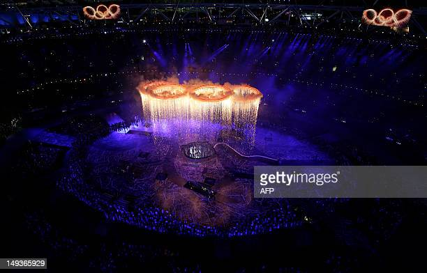 The Olympic rings light up Olympic Stadium during the Opening Ceremony of the 2012 London Olympic Games on July 27 2012 in London AFP PHOTO / Pool /...