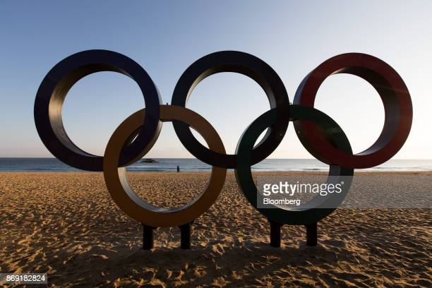 The Olympic rings stand at Gyeongpo beach near the Gangneung Ice Arena one of the venues for the 2018 PyeongChang Winter Olympic Games in Gangneung...