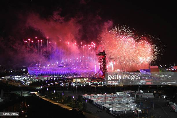 The Olympic Stadium is illuminated during the Opening Ceremony of the Olympic Games on July 28 2012 in London England Athletes heads of state and...