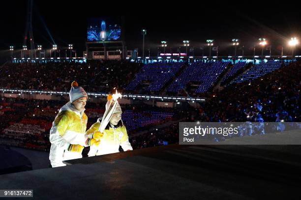 The Olympic torch is carried to the cauldron during the Opening Ceremony of the PyeongChang 2018 Winter Olympic Games at PyeongChang Olympic Stadium...