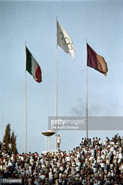 The Olympic torch is lit at the cauldron during the opening ceremony of the Rome Olympic Games at the Stadio Olimpico on August 25 1960 in Rome Italy