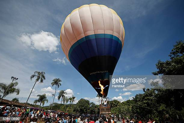 The Olympic Torch is taken up in a hot air balloon during Day 2 of the Olympic Flame torch relay on May 4 2016 in Corumba de Goias Brazil The Olympic...