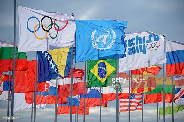 The Olympic, United Nations and Sochi 2014 flags fly in front of national flags in the Athletes Olympic Village prior to the Sochi 2014 Winter...