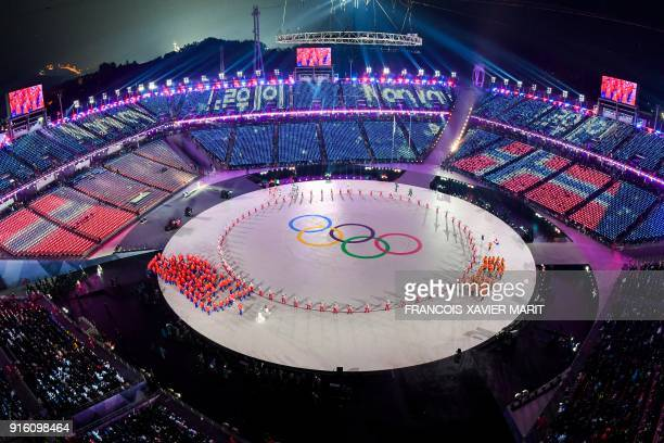 TOPSHOT The Olympics rings during the opening ceremony of the Pyeongchang 2018 Winter Olympic Games at the Pyeongchang Stadium on February 9 2018 /...