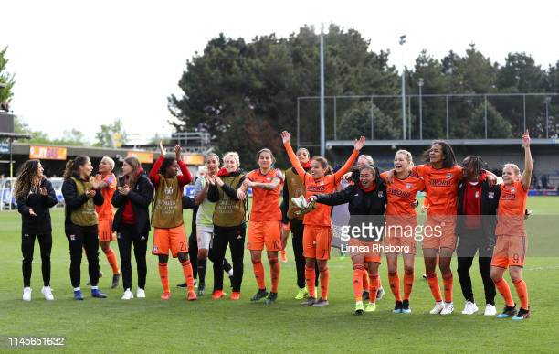 The Olympique Lyonnais Women team celebrate after the UEFA Women's UEFA Champions League Semi Final second leg match between Chelsea and Olympique...