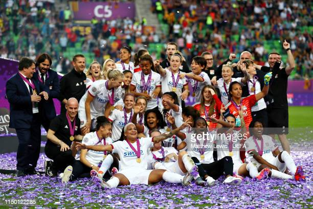 The Olympique Lyonnais Women team celebrate with the trophy after winning the UEFA Women's Champions League Final between Olympique Lyonnais Women...