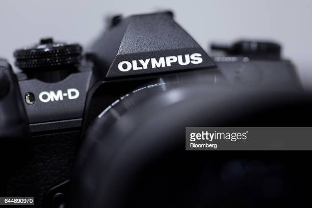 The Olympus Corp logo is displayed on the company's OMD EM1 Mark II mirrorless digital camera at the CP Camera and Photo Imaging Show in Yokohama...