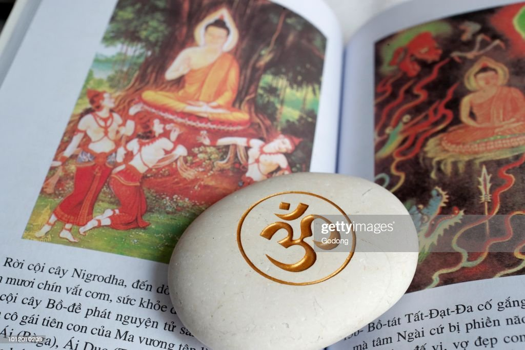 The Om Or Aum Symbol Of Hinduism And Buddhism On A White Stone Book