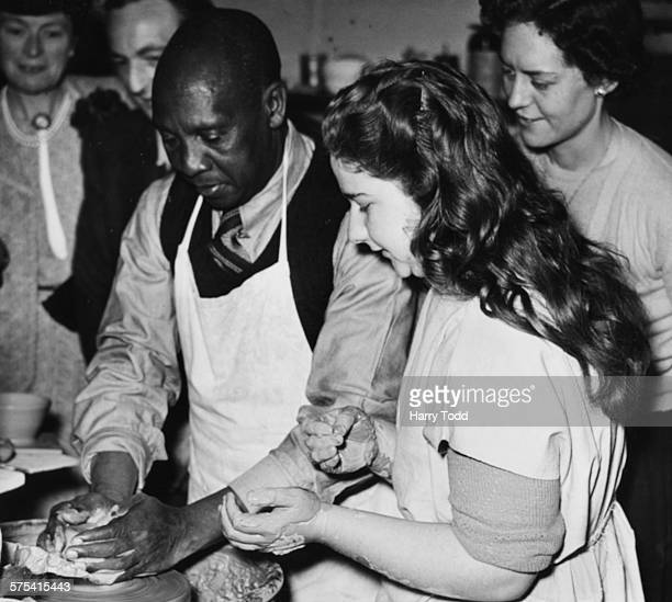 The Omukama Of BunyoroKitara the ruler of a 10000 strong tribe in Uganda tries his hand at making pottery at Fen Potteries in Huntingdon during a...
