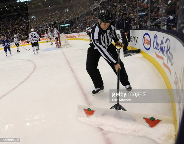 TORONTO DECEMBER 14 The on ice officials have to help the temporary ice crew clean the surface Toronto Maple Leafs vs Chicago Blackhawks during 1st...