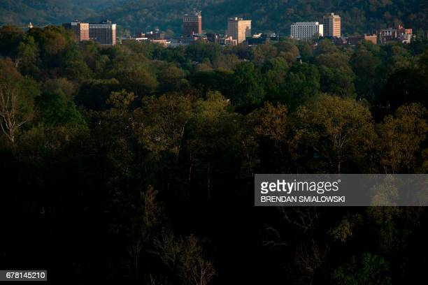 The once economically strong industrial city Huntington is seen nestled in trees along the Ohio River on April 20, 2017 in West Virginia. Huntington,...