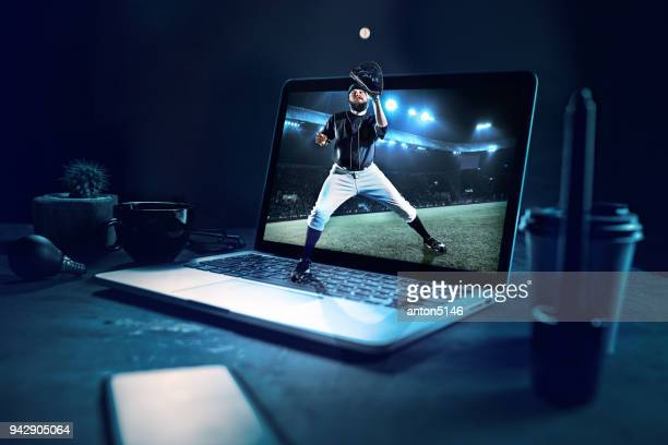 the one caucasian man as baseball player playing against stadium on the laptop. collage - baseball sport stock pictures, royalty-free photos & images
