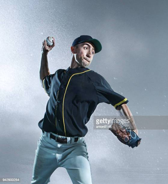 The one caucasian man as baseball player playing against stadium