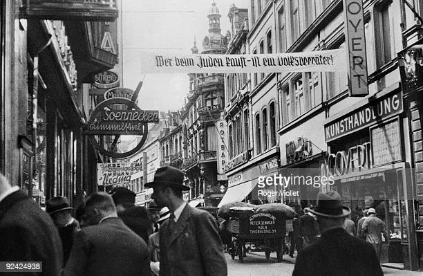 The one who buys at Jews' shops betrays his people AntiSemitic campaign in Cologne from 1933