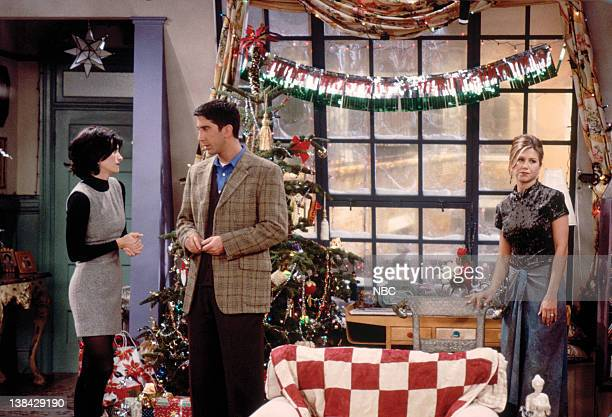 FRIENDS The One with Phoebe's Dad Episode 9 Pictured Courteney Cox Arquette as Monica Geller David Schwimmer as Ross Geller Jennifer Aniston as...