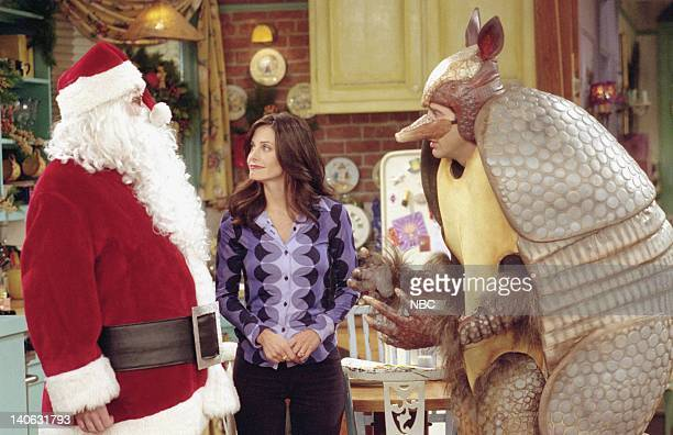 """The One with the Holiday Armadillo"""" -- Episode 10 -- Aired -- Pictured : Matthew Perry as Chandler Bing as """"Santa Claus"""", Courteney Cox as Monica..."""