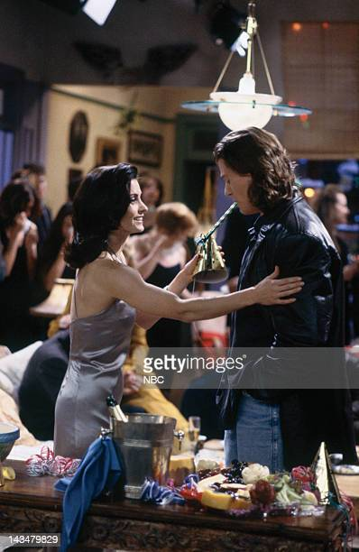 """The One With the Monkey"""" Episode 10 -- Pictured: Courteney Cox as Monica Geller, Vincent Ventresca as Fun Bobby"""