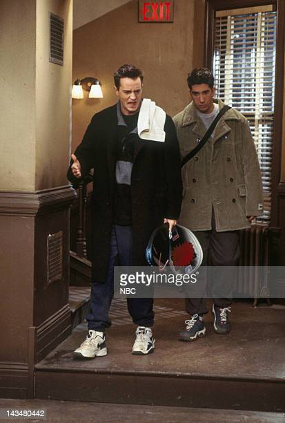 """The One with the Tiny T-Shirt"""" Episode 19 -- Pictured: Matthew Perry as Chandler Bing, David Schwimmer as Ross Geller"""