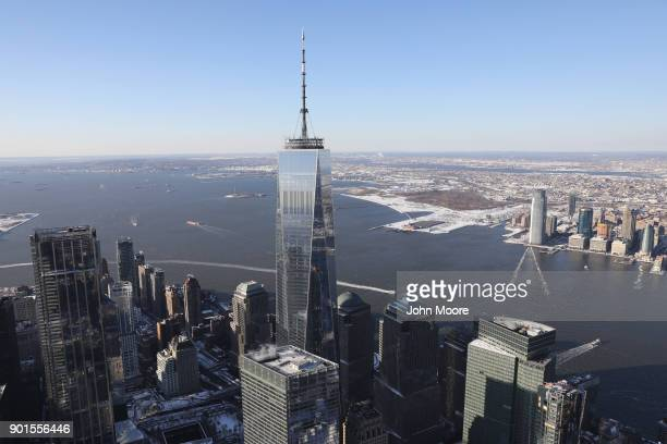The One World Trade Center rises over lower Manhattan on January 5 2018 in New York City Under frigid temperatures New York City dug out from the...