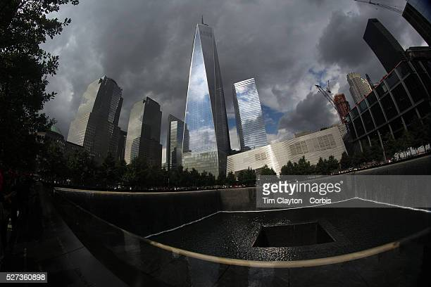 The One World Trade Center stands over the National September 11 Memorial in Downtown Manhattan New York City USA 16th September 2014 Photo Tim...