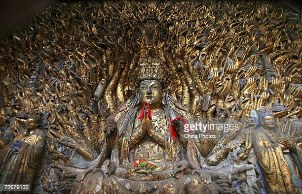 The Onethousandhand Goddess of Mercy sculpture is pictured at the Dazu Stone Carving Site on November 30 2006 in Dazu County of Chongqing...