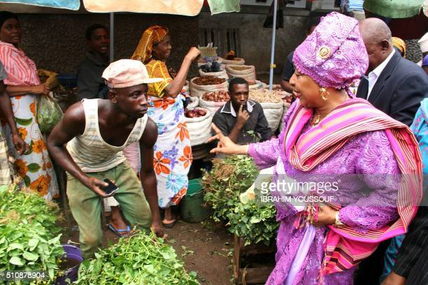 The only woman candidate for the Presidential election of Comoros Moinaecha Djalali smiles as she greets people during a visit to a market in Moroni...