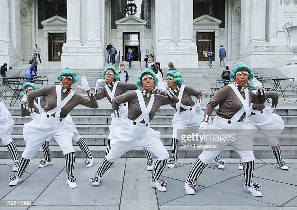 """The Oompa Loompas hand out Golden Tickets for the """"40th Anniversary of Willy Wonka & The Chocolate Factory"""" event on October 18, 2011 in New York..."""