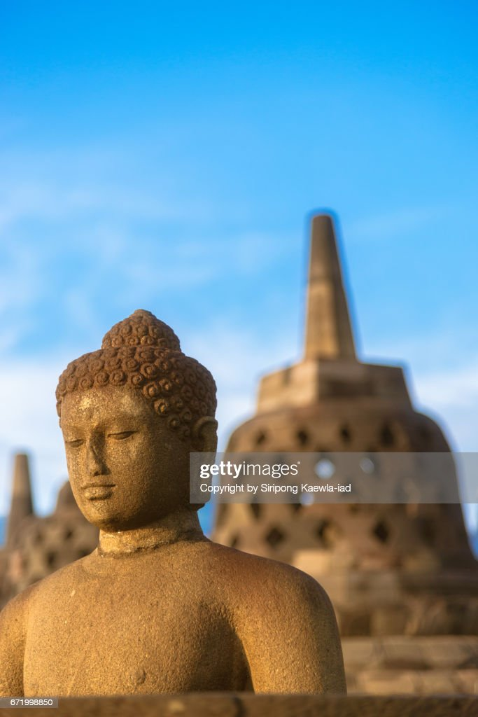 The open buddha statue with stupa in background at the Borobudur, Central Java, Indonesia. : Stock Photo
