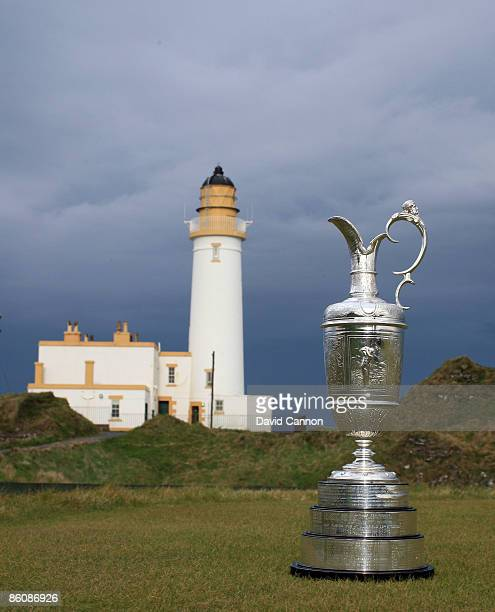 The Open Championship Trophy with the Lighthouse built on the remains of Robert the Bruce's Castle near the 9th and 10th holes on the Ailsa Course...