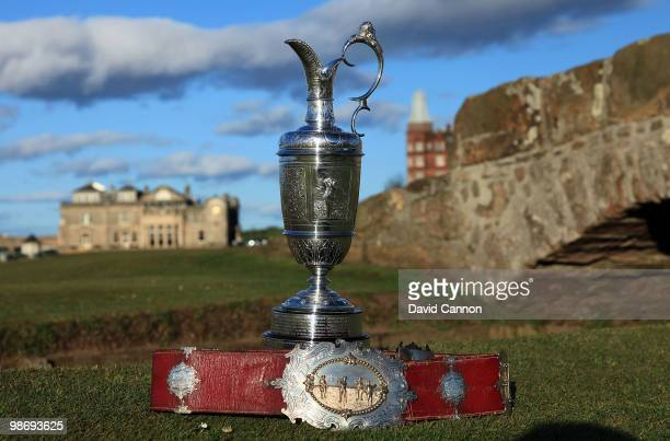 The Open Championship trophy with the original Champion Belt awarded to the early winners of the Championship A replica of the belt will be awarded...