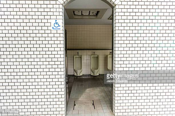 The open doorway to a public urinal in Japan.
