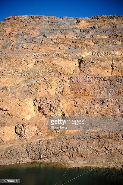 The open pit mine at Molycorp Inc's rare earths mining and processing facility stands in Mountain Pass California US on Monday Dec 13 2010 Molycorp...