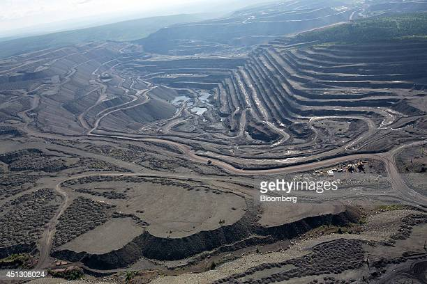 The open pit of the Neryungrinsky coal mine operated by OAO Mechel is seen in this aerial view in Neryungri Sakha Republic Russia on Wednesday June...