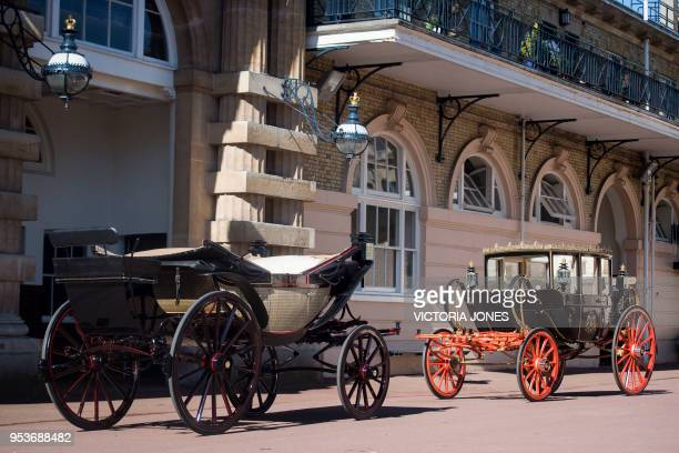 The open topped Ascot Landau carriage and the covered Scottish State Coach which will carry Britain's Prince Harry and wife Meghan Markle depending...