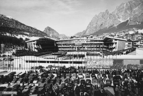 The opening ceremony of the 1956 Winter Olympics at the Olympic Ice Stadium the Dolomites visible beyond in Cortina d'Ampezzo Italy 26th January 1956